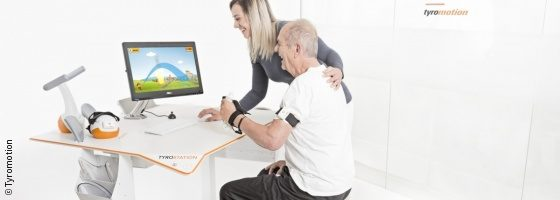 Photo: Elderly man during a rehabilitation unit with the Tyromotion system; Copyright: Tyromotion