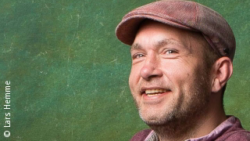 Photo: Lars Hemme with flatcap; Copyright: Lars Hemme