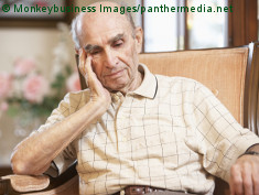 Photo: Elderly man sitting in an arm chair
