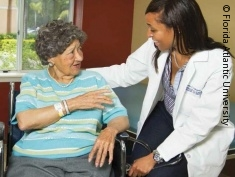 Photo: Elderly woman and caregiver
