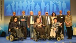 Photo: People standing on the stage; Copyright: European Disability Forum