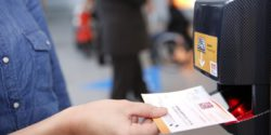 Photo: Woman using her ticket at REHACARE