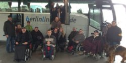 Photo: Mobility scouts in front of an accessible long-distance bus; Copyright: BSK