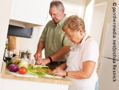Photo: Elderly couple cooking in the kitchen