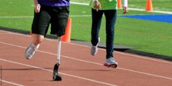 Photo: Man with prosthetic running on racetrack