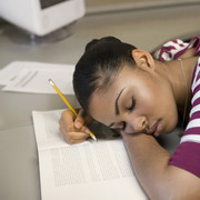 Photo: Girl sleeping on books
