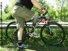Photo: Man with prosthesis and a bike