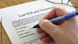 Photo: Person signs last will and testament; Copyright: panthermedia.net/BrianAJackson