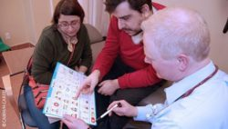Photo: Three people looking at the new Health Check toolkit; Copyright: CAMH/H-CARDD