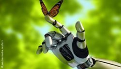 Image: Butterfly is sitting on a robot's hand; Copyright: panthermedia.net/lurii