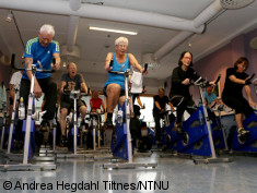 Photo: Elderly in a high intensity spinning class