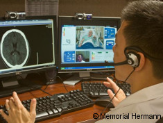 Photo: Researcher talks to a patient via telemedicine