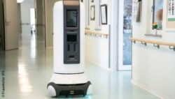 Photo: Robotic service assistant in a hospital hallway; Copyright: Fraunhofer IPA