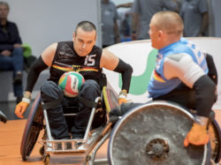 Photo: Two men playing wheelchair rugby in the Sports Center at REHACARE