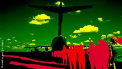 Photo: airplane in green and red - in front of it: red people