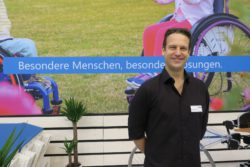 Photo: Marcel Sorg at his booth at REHACARE; Copyright: beta-web/Schlüter