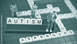 "Photo: board with figures and letters who build the word ""autism"""