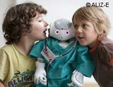 Photo: Two boys with a NAO robot