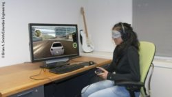 Photo: Female blindfolded participant playing a racing game with help of the RAD; Copyright: Brian A. Smith/Columbia Engineering