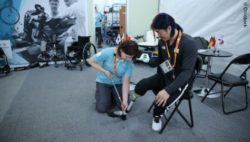 Photo: An Ottobock employee fitting a leg prostheses of an athlete during Winter Paralympics 2018; Copyright: Ottobock