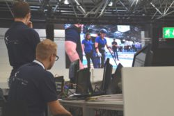 Photo: The media team of the CYBATHLON Experience watching the race at the big video screen; Copyright: beta-web/Hofmann