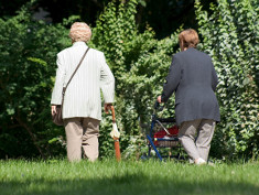 Photo: Elderly women with a wheeled walker