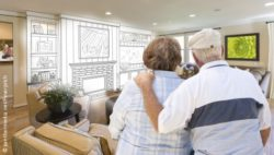 Photo: Elderly couple looking at a customized living room design; Copyright: panthermedia.net/Feverpitch