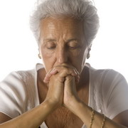 Photo: Older woman meditating