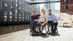 Photo: Three wheelchair users are posing in clothes of a adaptive fashion brand; Copyright: PantherMedia/Sergiy Tryapitsyn