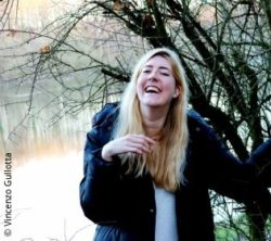 Photo: Nadine Kleine laughing outside; Copyright: Vincenzo Gullotta