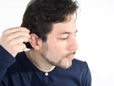 Photo: Man using a hearing aid
