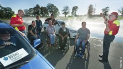 Photo: Several wheelchair users are at a training area for driver safety training; Copyright: BG BAU