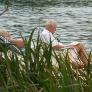 Photo: Elderly couple relaxing at the beach