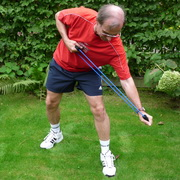 Photo: Older man doing stretching exercise with a rope