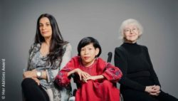 Image: A tall woman, a woman in a wheelchair and an older woman sit next to each other; Copyright: Her Abilities Award