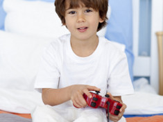 Photo: Child playing a video game