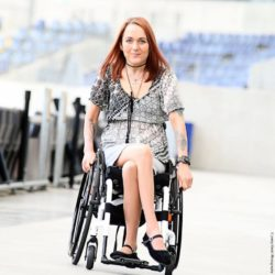 Photo: Claudia Neun in her wheelchair; Copyright: Jenny Klestil Photography