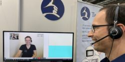 Photo: Ron Hattenhorst demonstrating the remote interpreting service at REHACARE 2019; Copyright: beta-web