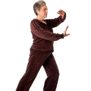 Photo: Woman makes Tai Chi