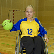 Photo: Girl in wheelchair holding a ball