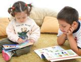 Photo: Children reading a picture book