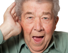 Photo: Old man with hearing problems