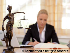 Photo: Lady Justice and a woman in the background