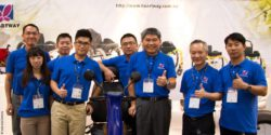 Image: The team of Heartway Medical Products in front of their booth, waering blue polo shirts; Copyright: beta-web/Schmitz