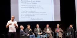 Photo: Sign language interpreter in the REHACARE Forum; Copyright: Messe Düsseldorf