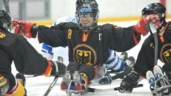 Photo: Frank Rennhack with his team mates on the ice during a Para Ice Hockey game; Copyright: IPC
