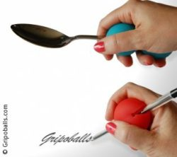 "Image: Hand holds a ball with a pen writing the word ""Gripoballs"", another hand holds a toothbrush ; Copyright: Gripoballs"