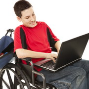 Photo: Boy with wheelchair plays video game