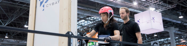 Photo: Female participant of the CYBATHLON Experience 2017 tries to open a door during the course