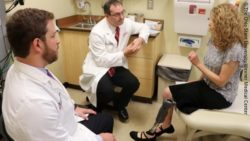 Photo: Two doctors and a female amputee talking to each other; Copyright: The Ohio State University Wexner Medical Center